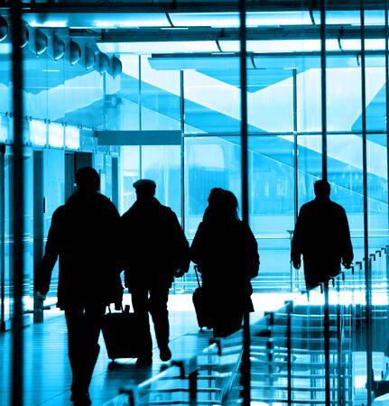 rushing: Passengers at the airport rushing to their flights