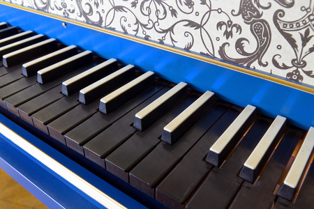 Detail of old harpsichord keyboard with black keys, close-up view