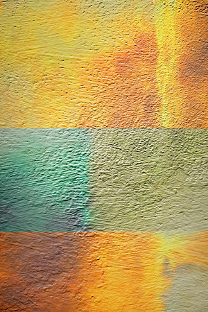 Wall stucco background with yellow stains and green line Standard-Bild