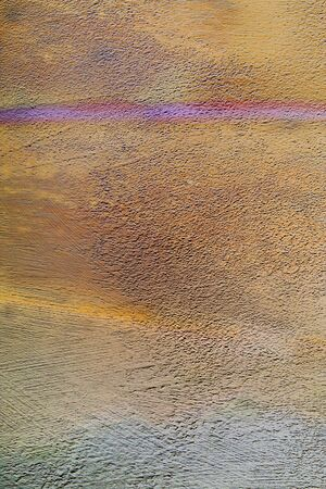 Wall stucco background with beige stains and purple line