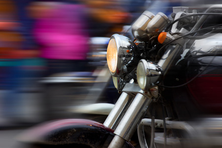 motorcycle rushing at city street blurred motion Foto de archivo