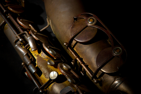 Old saxophone in a case close-up