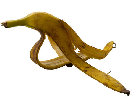 dross: Slippery peel of a banana dangerous at falling isolated on a white background
