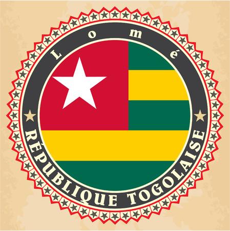 togo: Vintage label cards of Togo flag. Vector illustration