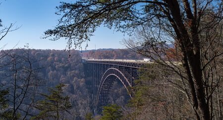 A long tall arched bridge over a gorge.
