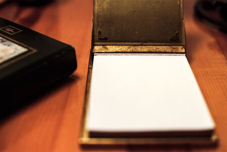 A Notepad Sits Ready and Open to be Used