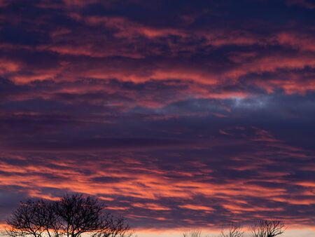A colorful display of pink, blue and purple clouds at sunset. Stock Photo