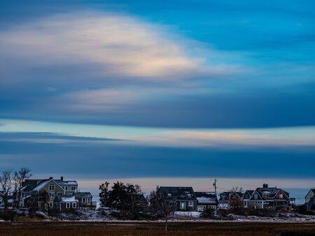 Homes Along The Edge Of A Salt Marsh In Sandwich Massachusetts