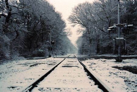 Train Tracks Disappear Into The Distance In A Snow Storm