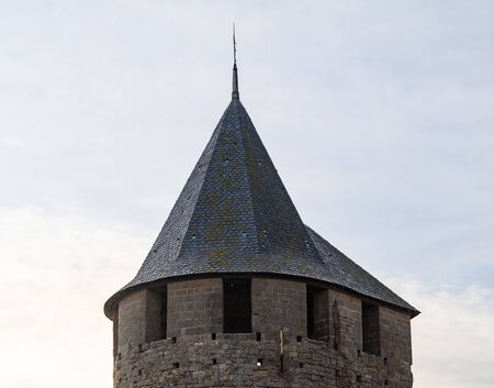 The Crenelated Roof Of A Conical Tower In Carcassonne