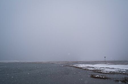 Snow Falls Over A Winter Nature Scene Of A Salt Marsh