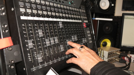 audio mixer: Hand of the professional audio musical mixer