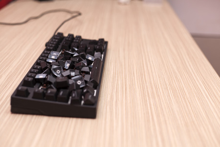 Completely smashed broken used mechanical computer keyboard