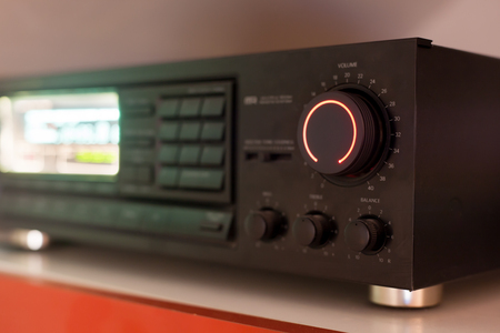 Stereo receiver or amplifier with the volume knob turned up to the maximum