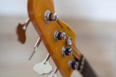 Bass guitar headstock and chrome tuning keys