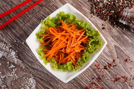 korean salad: Korean carrot on listyayh salad in a white cup Stock Photo