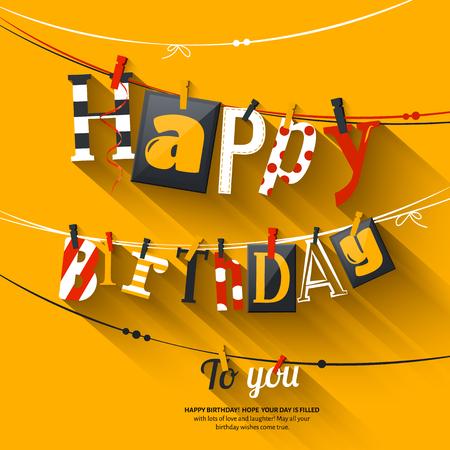 誕生日カード。洗濯はさみとカラフルな文字のロープでハングアップします。