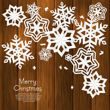 wooden cut: Christmas card with cut out paper snowflakes and wishing text on brown wooden background, wall. Illustration