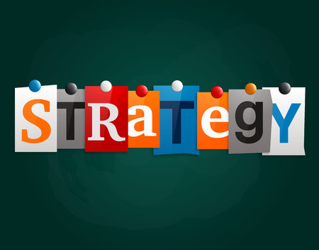 The word Strategy made from newspaper letters attached to a blackboard or noticeboard with magnets.