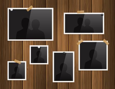 Fotolijsten bevestigd met plakband en punaises op houten achtergrond. Vector.