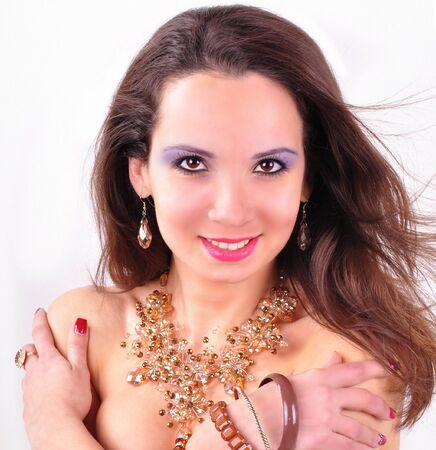 Beautiful fashion woman with jewelry accessories photo