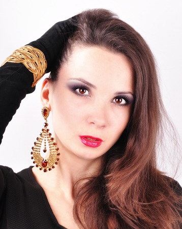 extravagant: young beautiful dark-haired girl in extravagant earrings