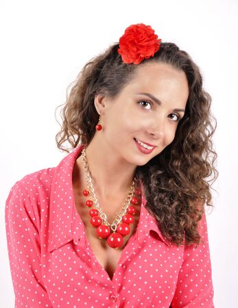 fake eyelashes: young girl with a red necklace on a white backgroun Stock Photo