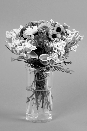 bouquet of flowers in a glass vase.black and white image Banco de Imagens