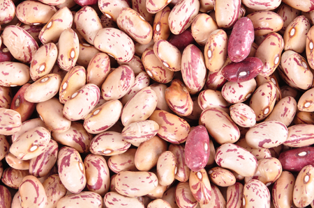 Colored haricot beans closeup on a background, top view, beans background