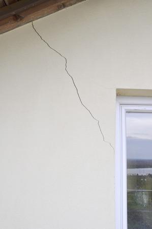 plaster wall with cracks. Building requiring repair .closeup