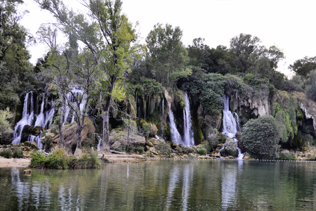 Beautiful Kravica waterfall in Bosnia and Herzegovina - popular swimming and picnic area for tourists