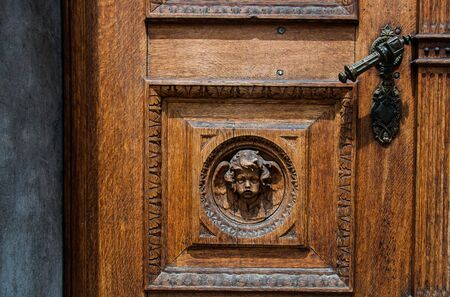 Old wooden door with iron handle on the Franciscans Church of the Annunciation in Ljubljana, Slovenia Stock Photo