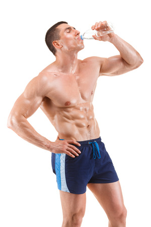 appease: Young muscular man drinking water, isolated on white background