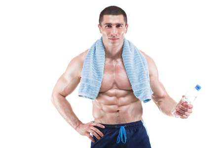 appease: Young muscular man with blue towel over neck, drinking water, isolated on white background