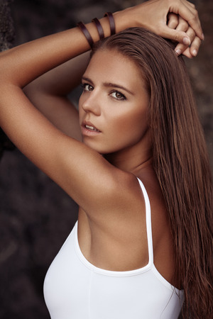 Portrait of beautiful woman with tan at the beach