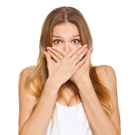 Surprised happy beautiful woman covering her mouth with hand. isolated over white background
