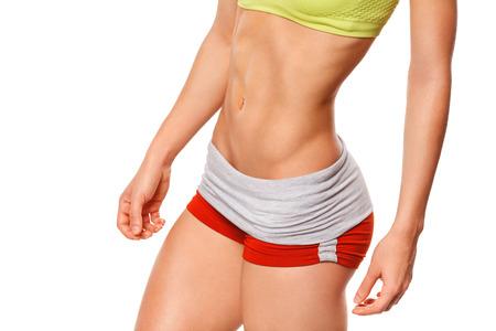 culo di donna: Donna di forma fisica che mostra addominali e pancia piatta. Sexy donna muscolare