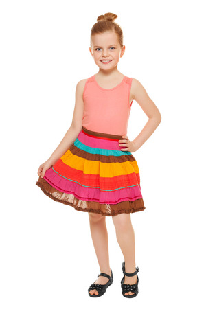 Little happy girl full lenght in colorful skirt, isolated on white background