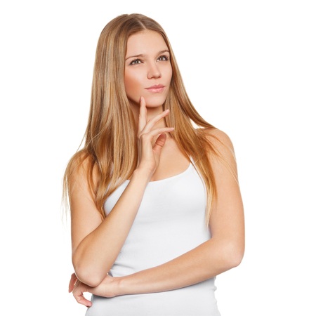 Young beautiful woman thinking looking to the side at blank copy space