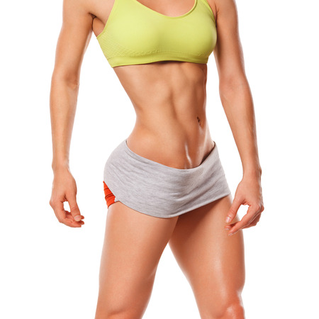 nude abs: Fitness woman showing abs and flat belly. Sexy muscular woman Stock Photo