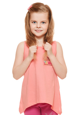 cute little girl: Little cute girl in a pink shirt holds hands hair, isolated on white background