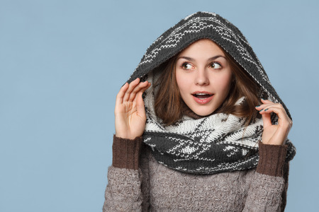 muffle: Surprised christmas girl wearing knitted wear scarf. Excited  beautiful smiling girl, winter concept, isolated