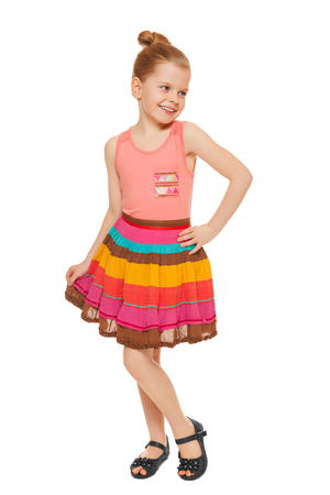 full lenght: Happy little girl full lenght in colorful skirt, isolated on white background Stock Photo
