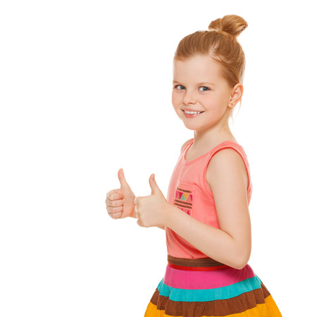 little girl surprised: Happy joyful little girl smiling showing thumbs up, isolated on white background