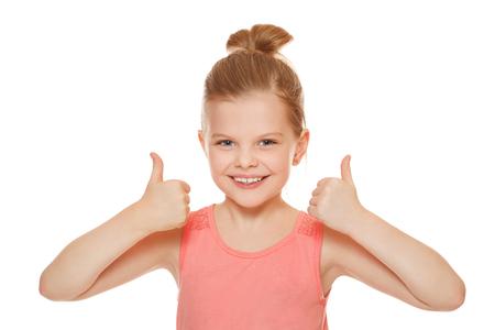 little finger: Happy joyful little girl smiling showing thumbs up, isolated on white background