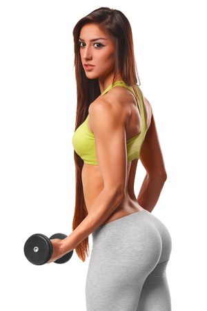 woman naked body: Sexy athletic woman working out with dumbbells. Sexy beautiful ass in thong. Fitness girl, Isolated on white background