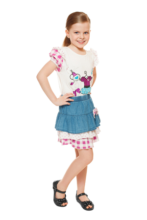 Fashionable little cute girl in shirt and skirt, full length, isolated on white background