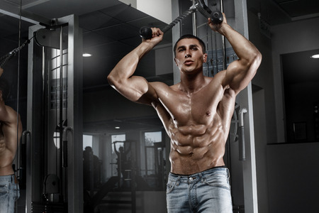 nude abs: Sexy muscular man working out in gym, shaped abdominal. Strong male naked torso abs Stock Photo