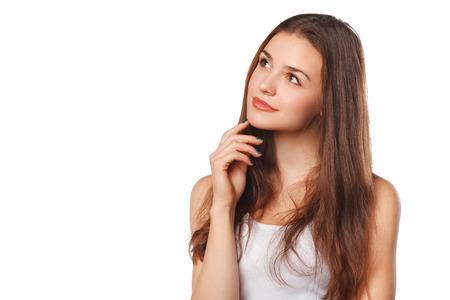 Jonge mooie vrouw denken op zoek naar de kant op lege kopie ruimte, geïsoleerd op een witte achtergrond Stockfoto