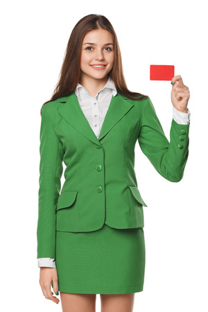 woman business suit: Smiling business woman showing blank credit card in green suit, isolated over white background